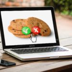 laptop with image of cookies and option to accept or decline