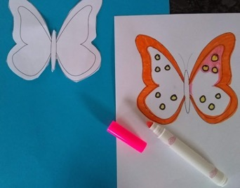 Using a marker to color a butterfly