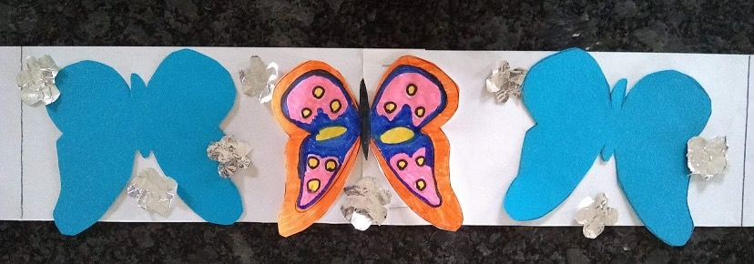 Butterflies and flowers cut out on white paper