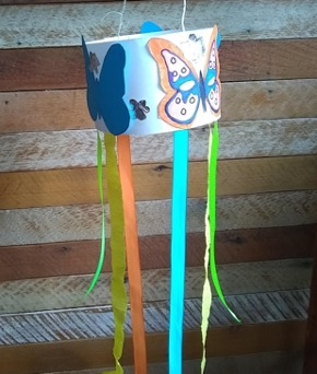 A windcatcher with ribbon streamers and butterfly decorations