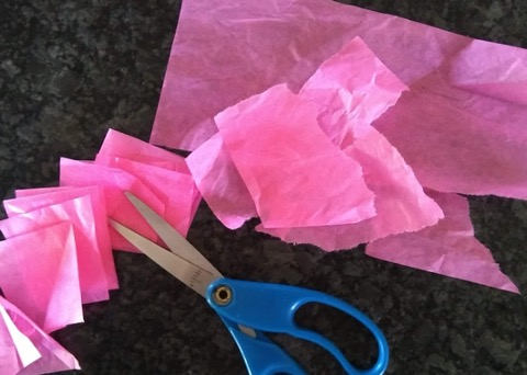 Cut up pink tissue paper