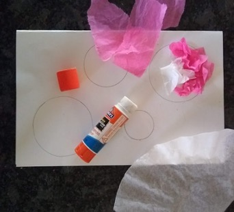 Gluing tissue paper to traced circles