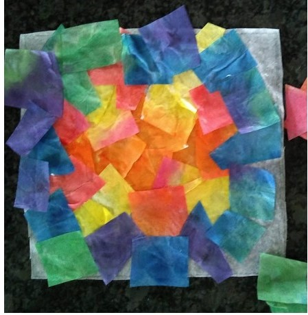 Glue your tissue paper to the wax paper