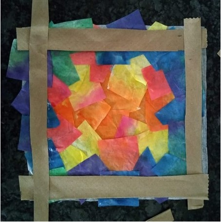 Create a frame with the paper bag strips