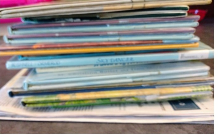 Weight the newspaper with books