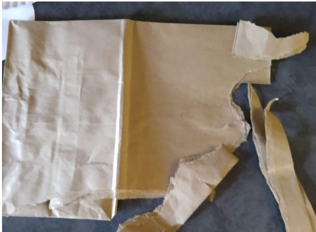 Tear a paper bag into strips