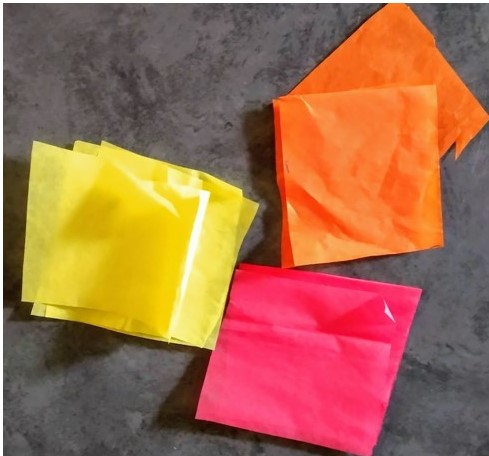 Cut the tissue paper into squares